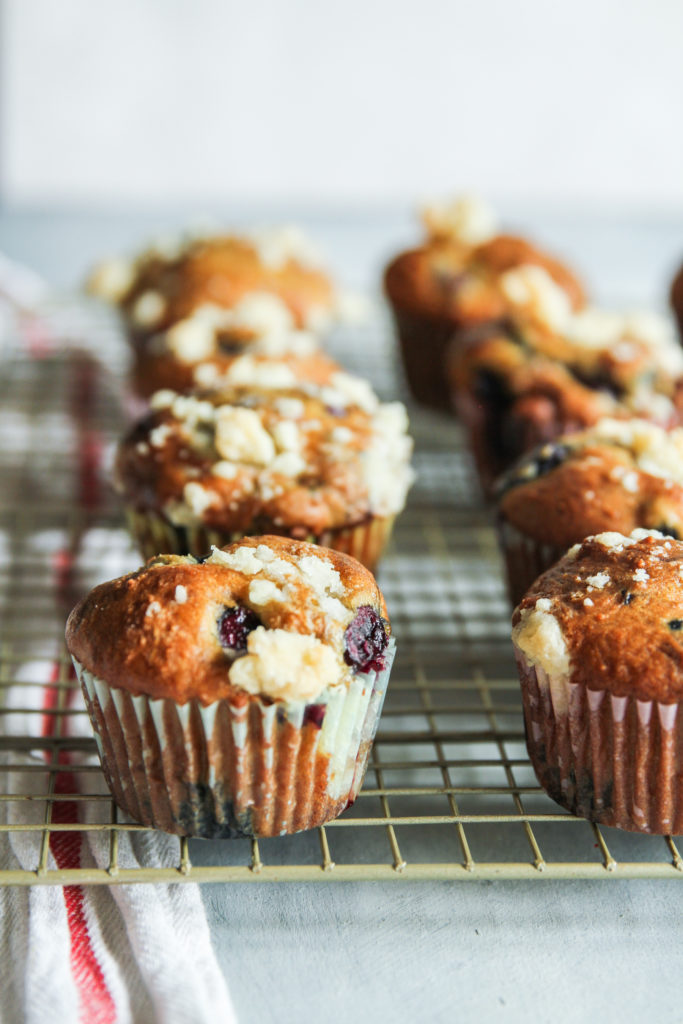 Best blueberry cherry muffins made with Greek yogurt and a streusel topping on a cooling rack