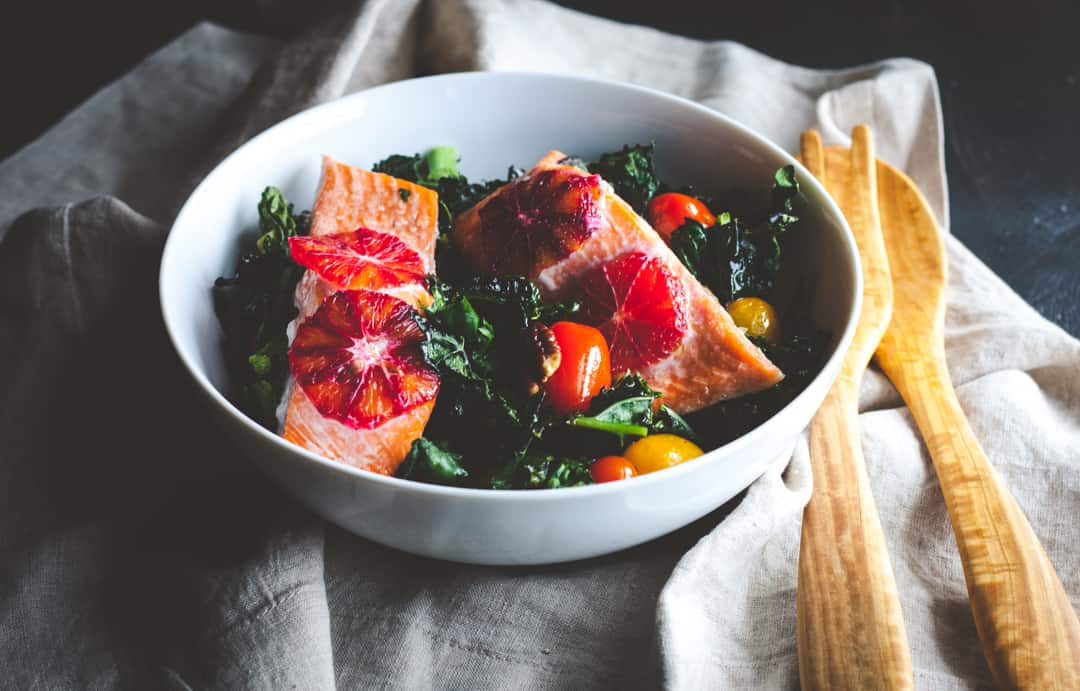 Super delicious roasted kale and salmon salad that is healthy