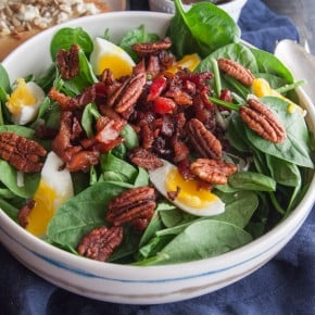 Spinach salad with soft boiled eggs bacon and a mustard vinaigrette from SweetPhi