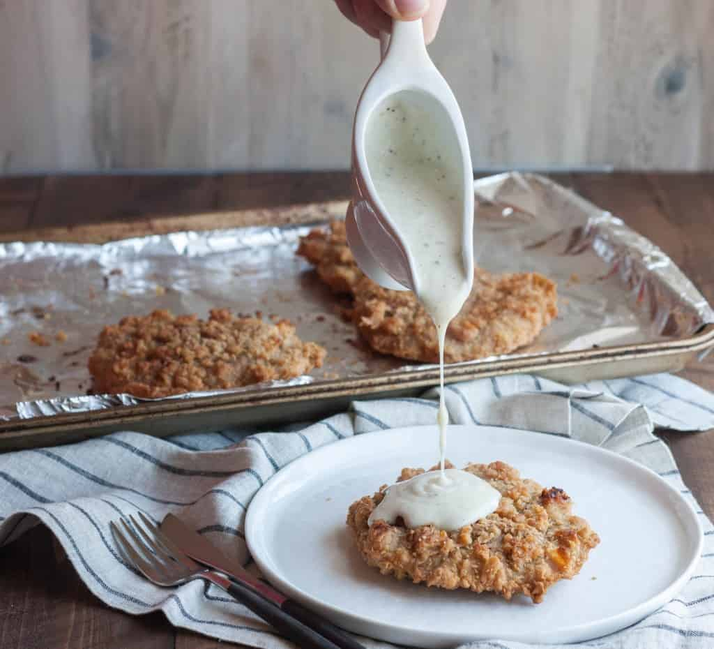 Homemade white peppercorn gravy is a perfect topping for chicken fried steaks