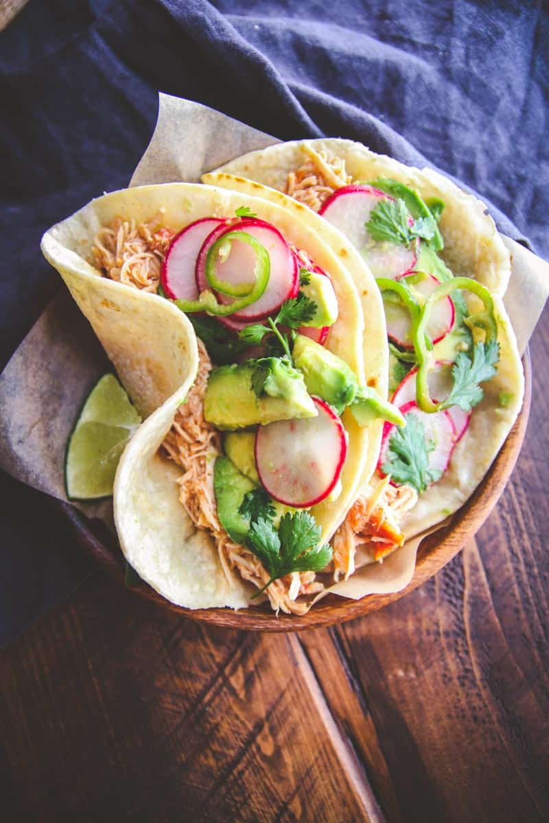 The best and most flavorful slow roasted chicken tacos with radish slaw to make