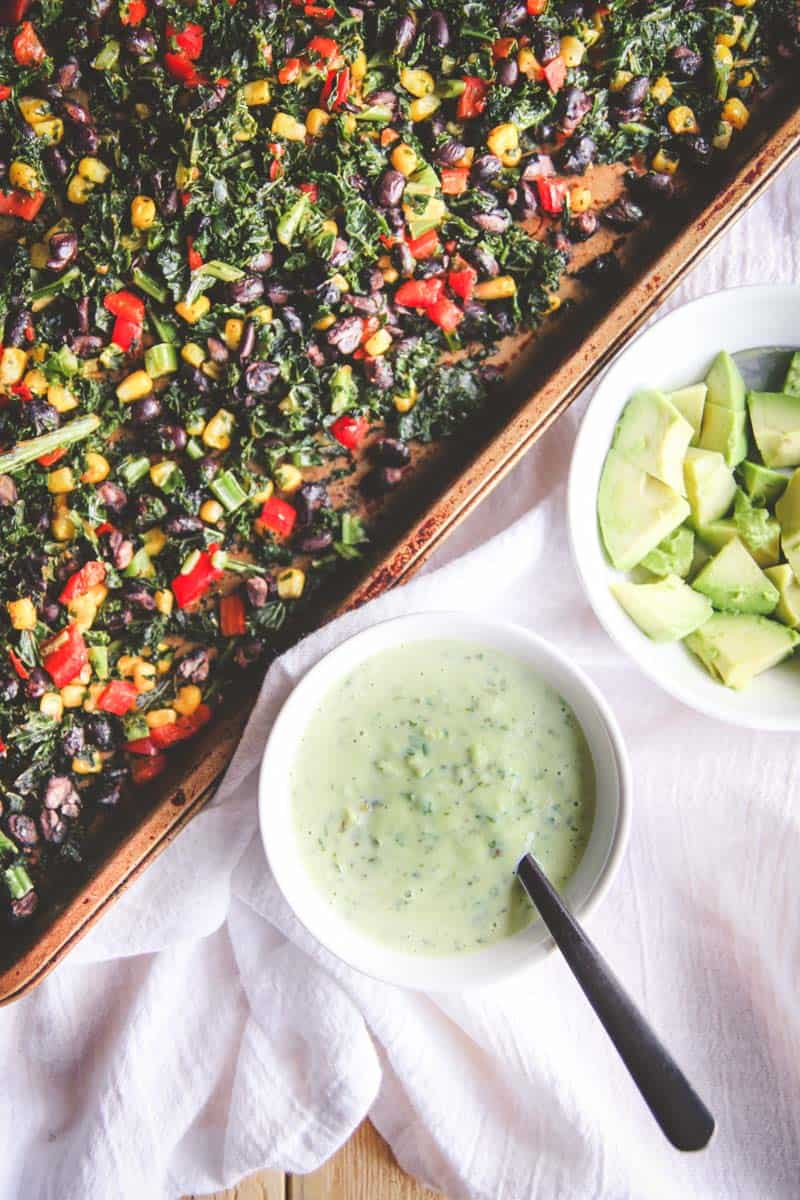 The best vegetarian sheet pan dinner with Mexican kale salad and avocado