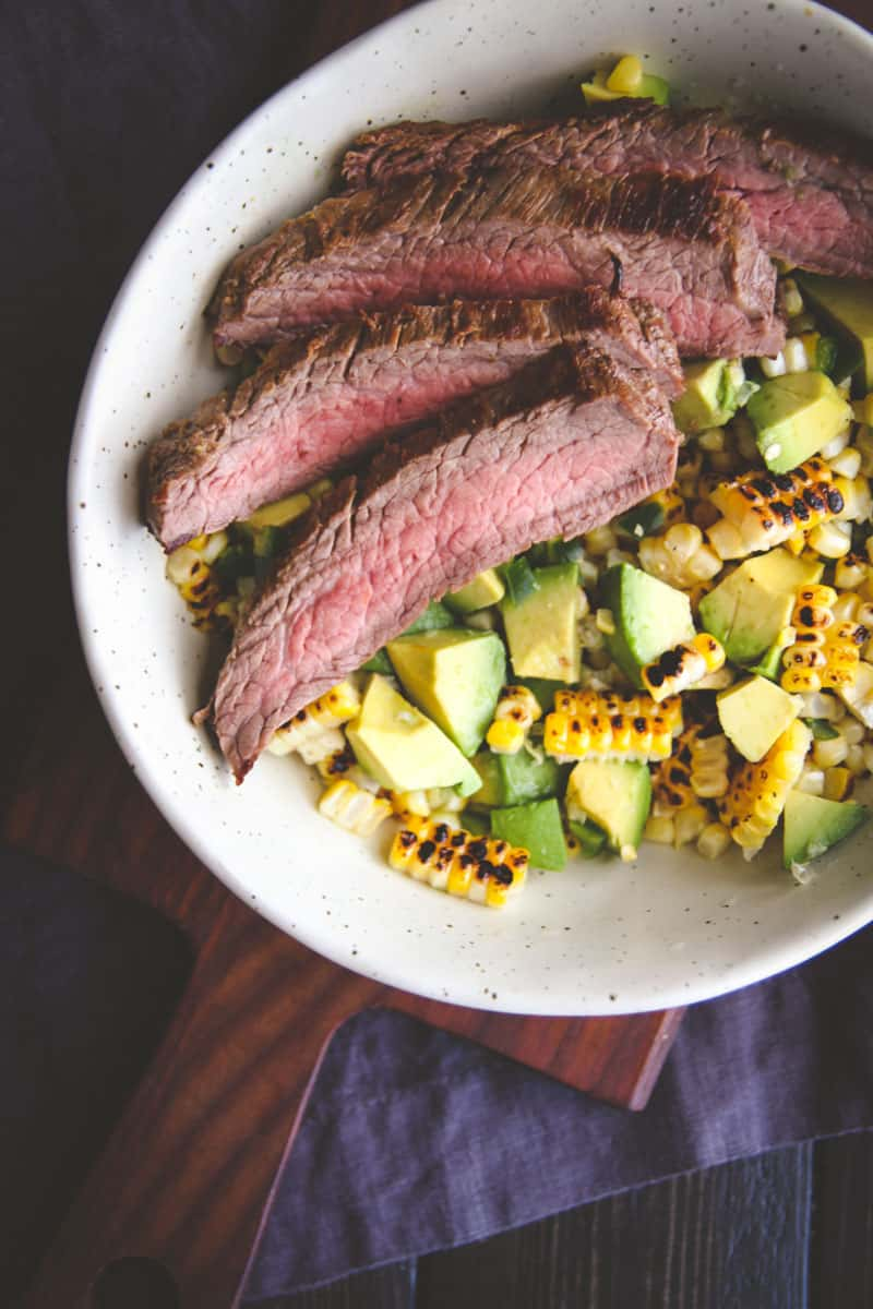 The best flank steak with hcarred corn salad