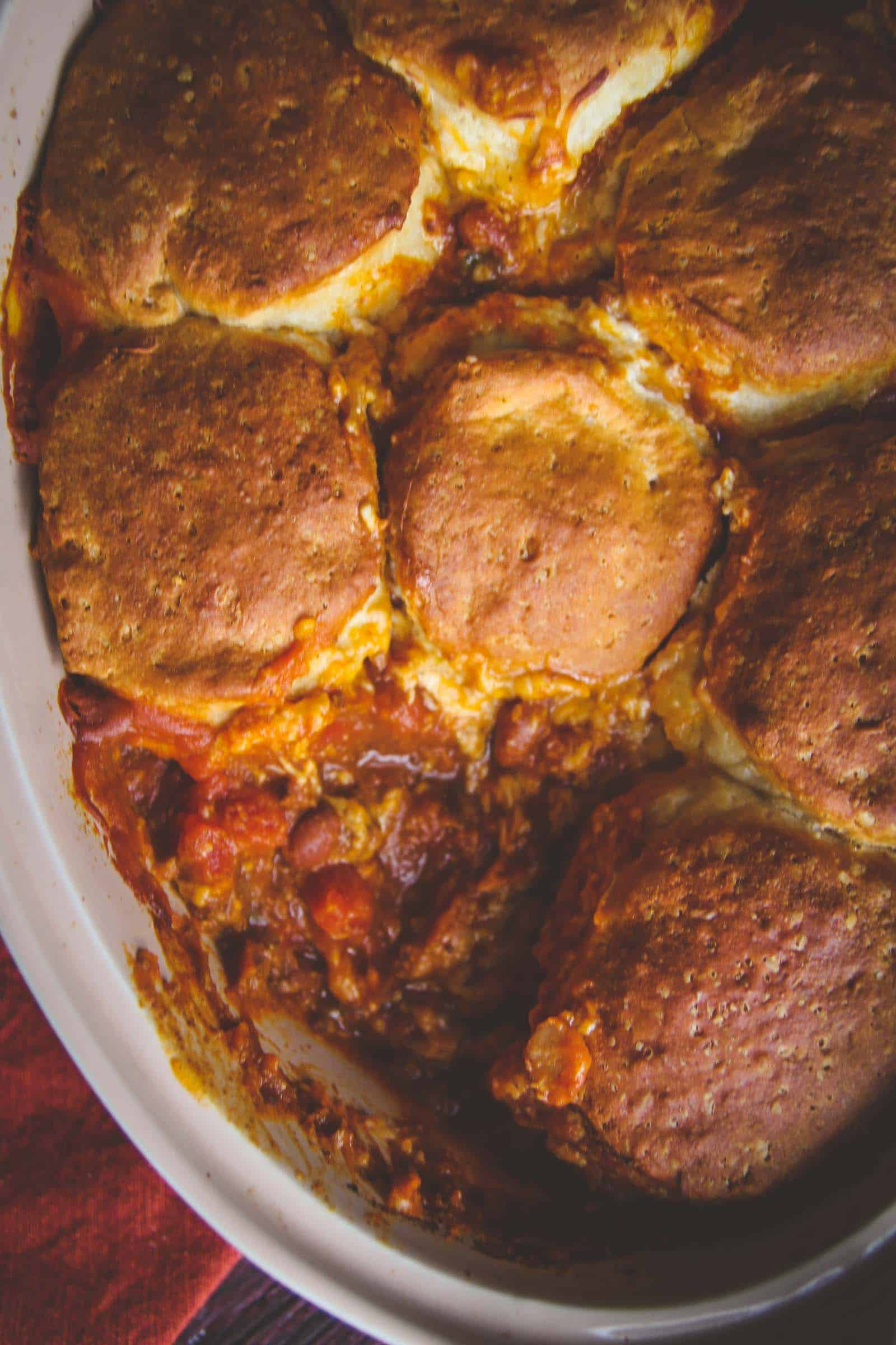 The perfect fall dinner idea is these 5 ingedient pumpkin chili biscuit bake