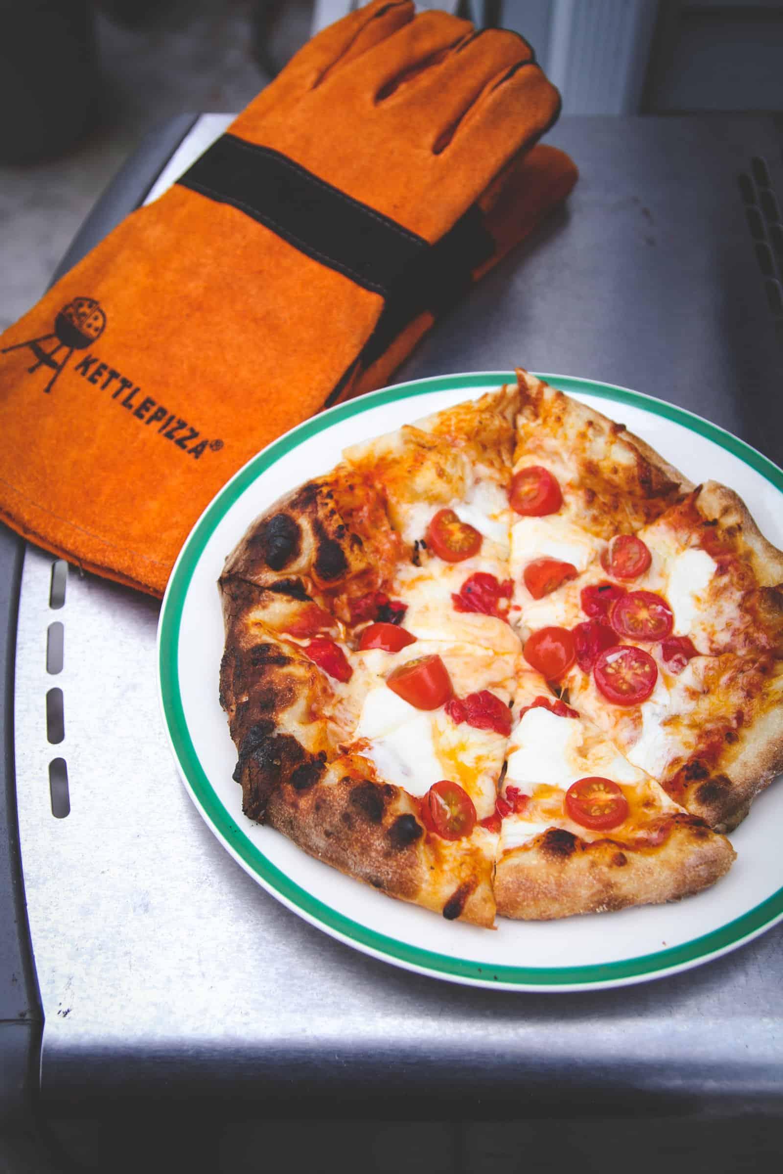 The most delicious tomato mozzarella pizza cooked on the grill
