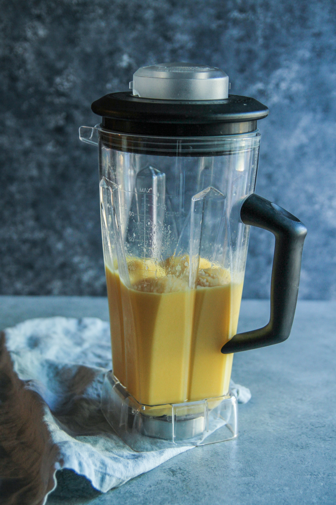 Easy breakfast smoothie with orange, mango and pineapple