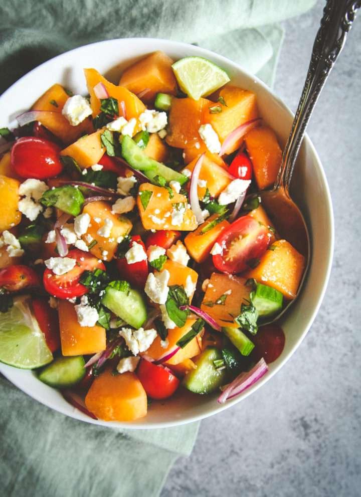 Summer melon cucumber tomato feta salad, summer fruit and feta salad, melon cucumber salad with a honey dressing