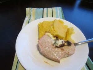 Pork Tenderloin Stuffed with Spinach, Sundried Tomatoes and Goat cheese, and cheesy polenta