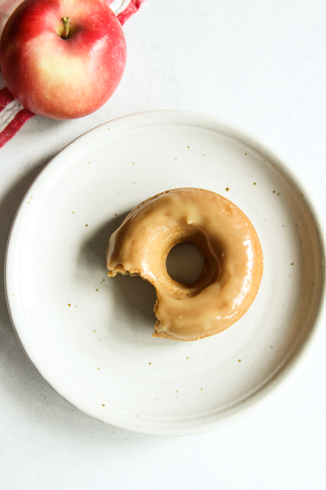 Healthy apple cider donuts with a tahini maple glaze, baked donut recipe, healthy kids dessert recipe, toddler dessert donuts, healthy toddler dessert, healthy family sweets recipe