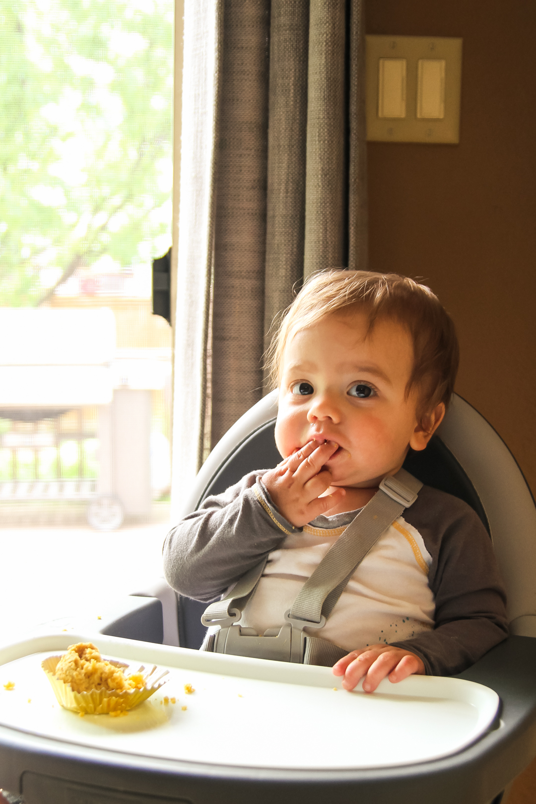 baby eating a sweet potato cornbread muffin for a healthy snack