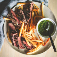 Easy grilled steak and chimichurri sauce with fries