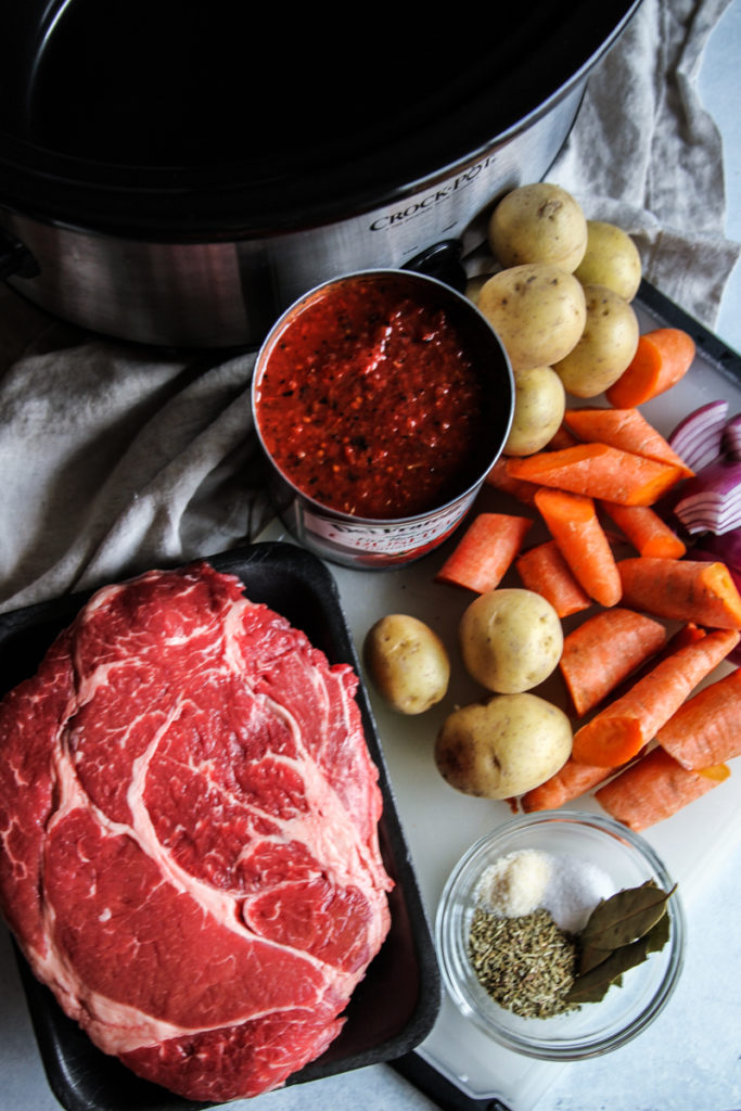 Slow Cooker beef pot roast in a fire roasted tomato sauce, slow cooker tomato pot roast, fire roasted tomato roast, slow cooker pot roast, easy slow cooker beef roast recipe, crockpot beef roast