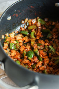 cooking onions and bell peppers for one pot sausage and rice casserole