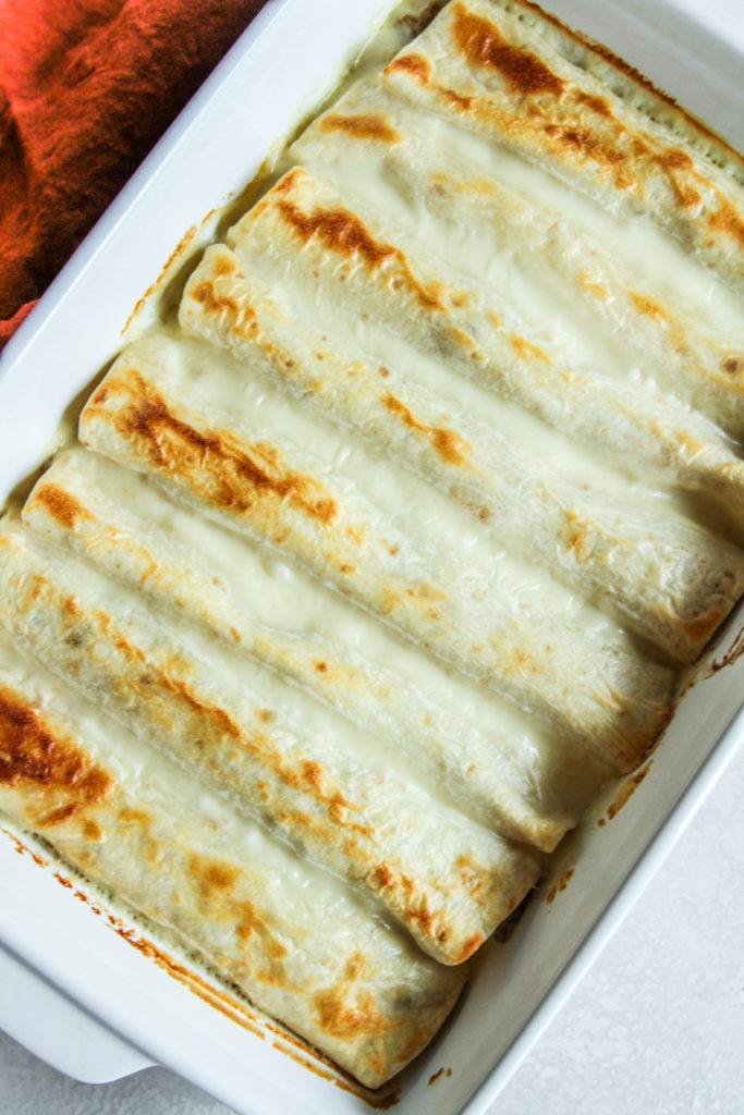The best ever enchiladas with cheese sauce and ground turkey
