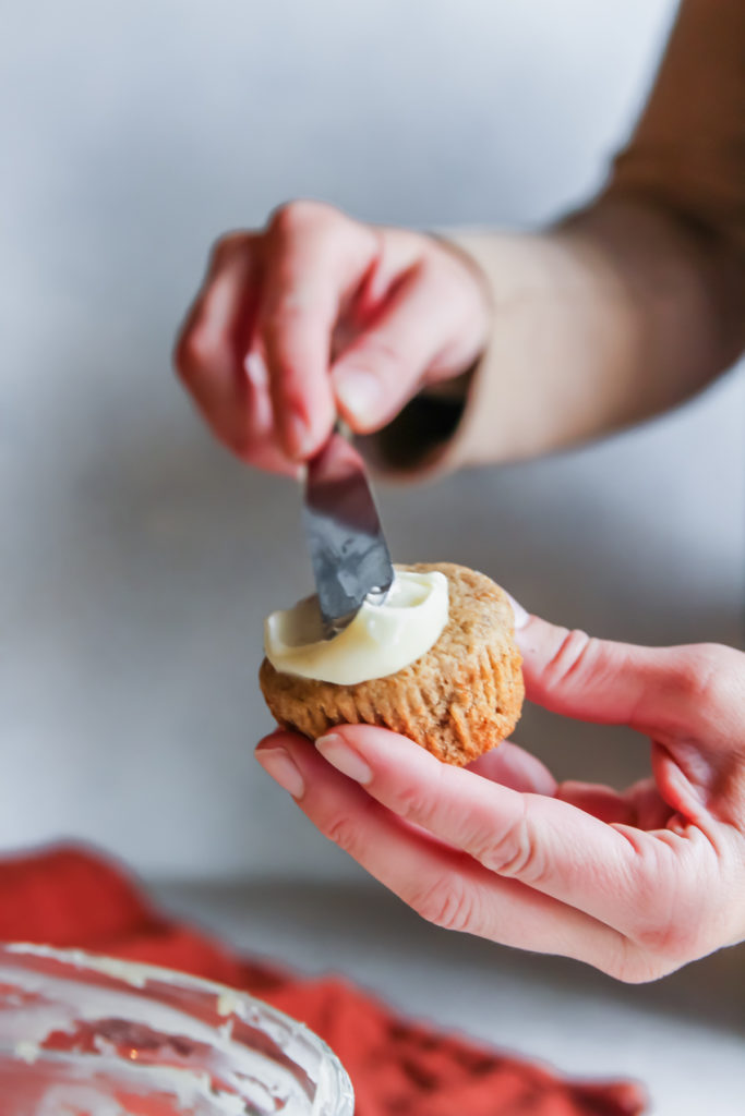 Cream cheese frosting on a gingerbread muffin