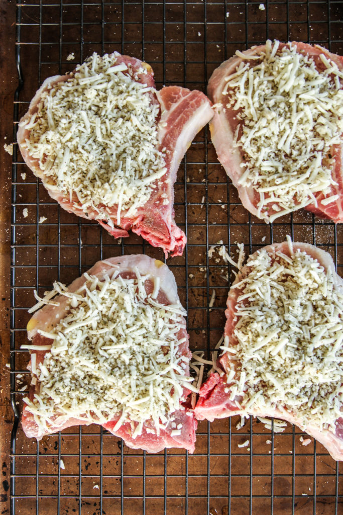 Bone in pork chops with a cheesy crunchy topping