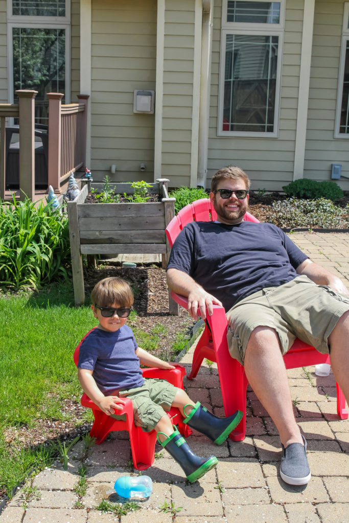 Father and son matching outfits and grilling for the first time