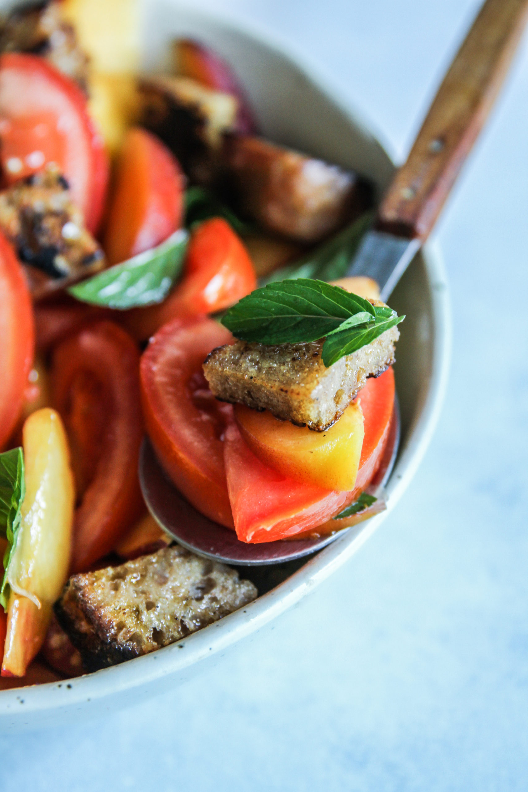 The best salad with peaces, tomatoes and sourdough croutons