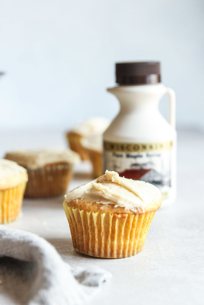 Maple syrup cupcakes and small cake with maple syrup bottle