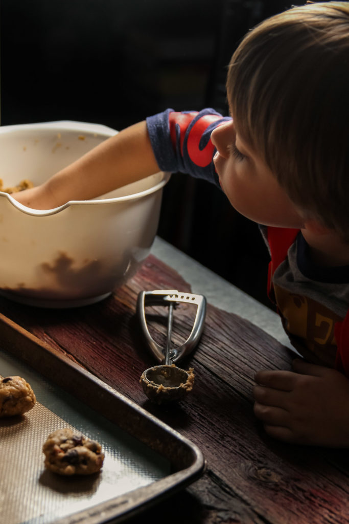 Making oatmeal chocolate chip cookies with a toddler