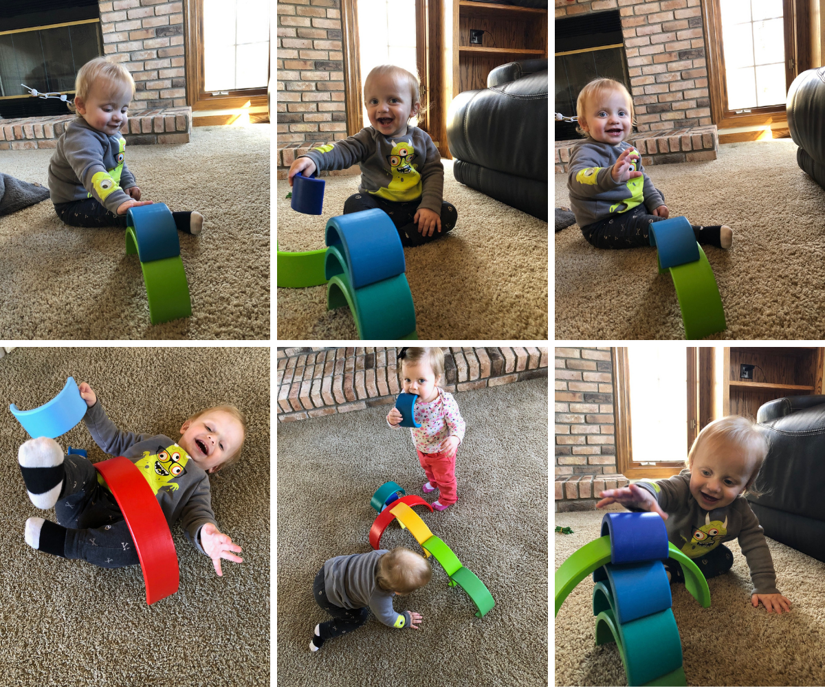 Kids playing with stacking rainbows