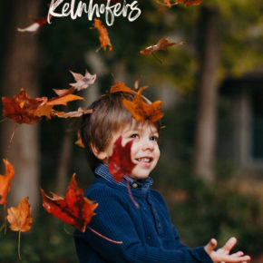 Toddler throwing leaves in the air