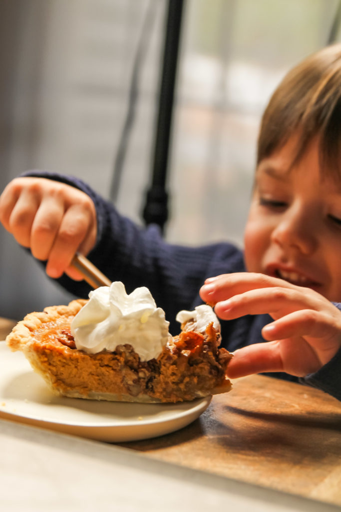 toddler enjoying pumpkin pecan pie