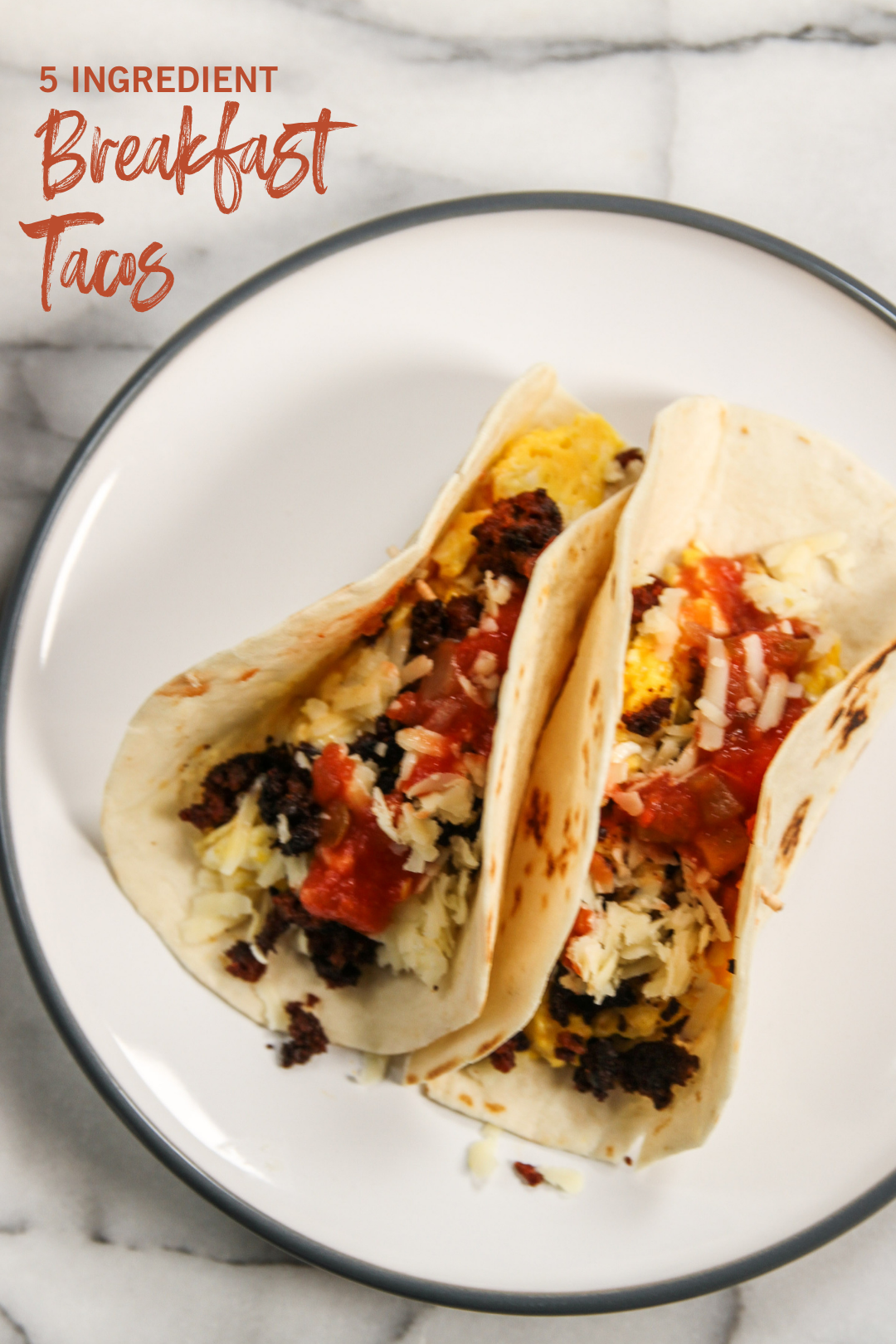 Two breakfast tacos on a white plate