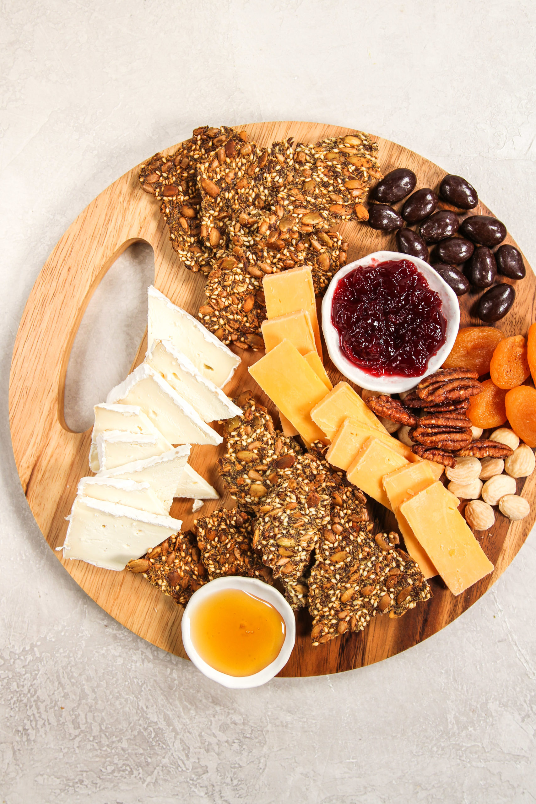 Charcuterie board with homemade seed crackers
