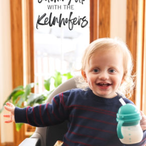 Toddler in a high chair with a sippy cup