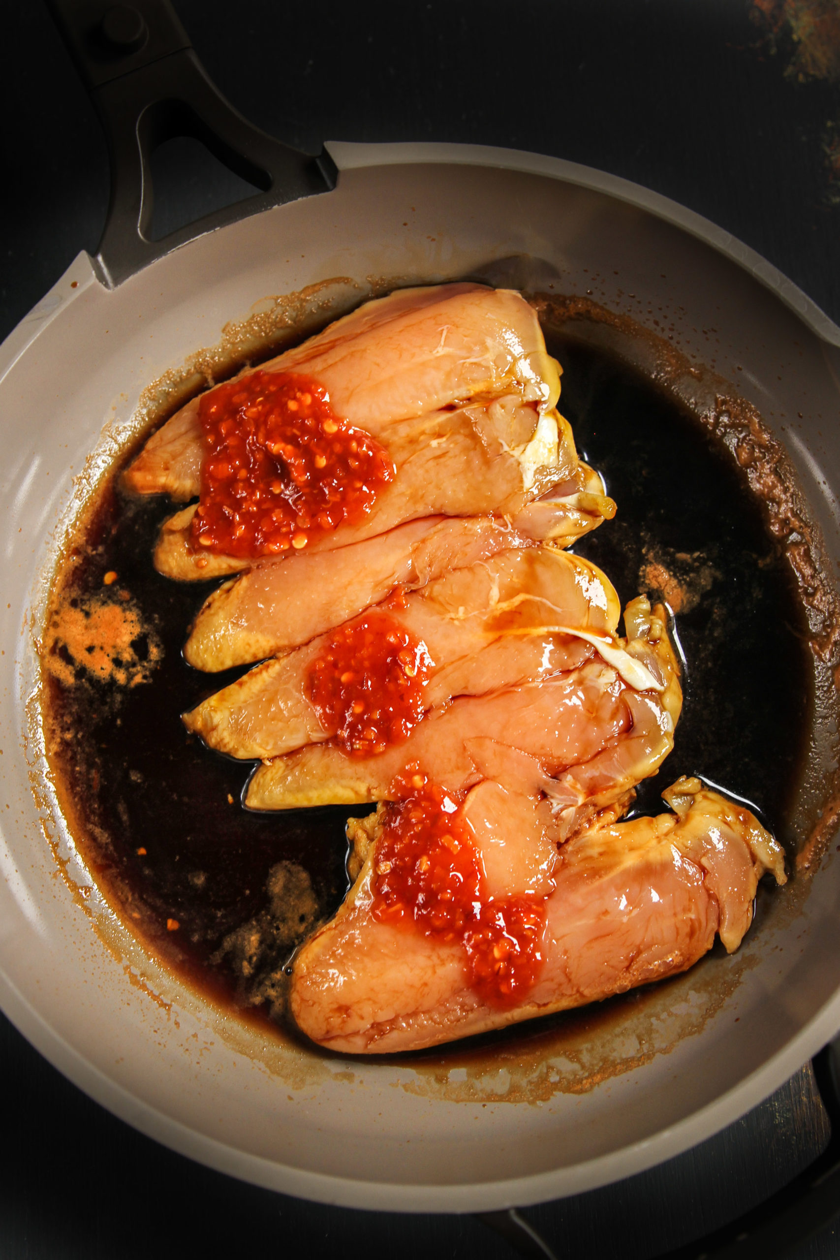 Chicken tenderloin in a pan with chili paste and soy sauce