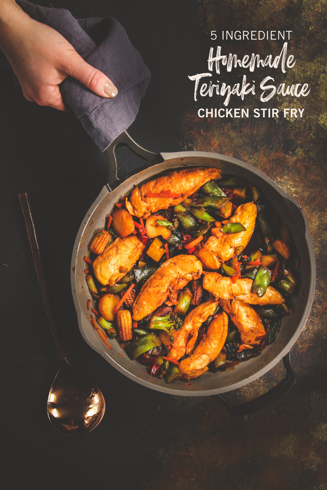 Homemade teriyaki sauce chicken stir fry in a skillet with hand
