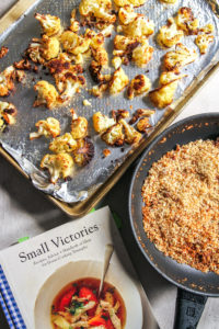 Small Victories cookbook and sheet pan with anchovy breadcumbs