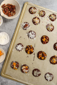 Variety of toppings on chocolate coins